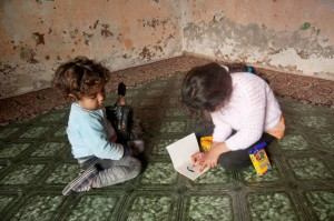Syrian orphans testing out their new school supplies