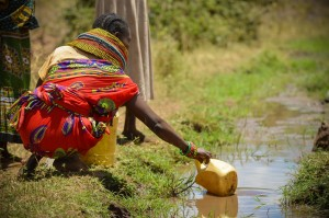 Woman collecting water for her family